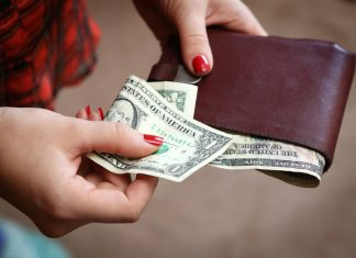 How does Atlanta spend its money? Hands with wallet and cash