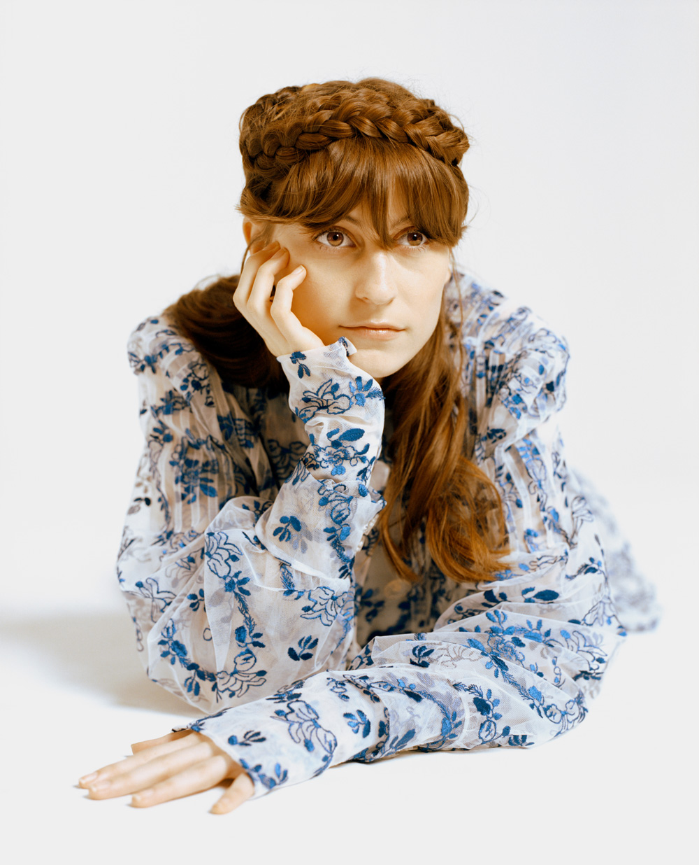 Faye Webster wearing a blue floral jacket from Simone Rocha