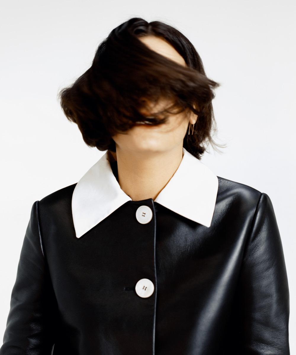 Mattiel Brown in a black leather Prada jacket