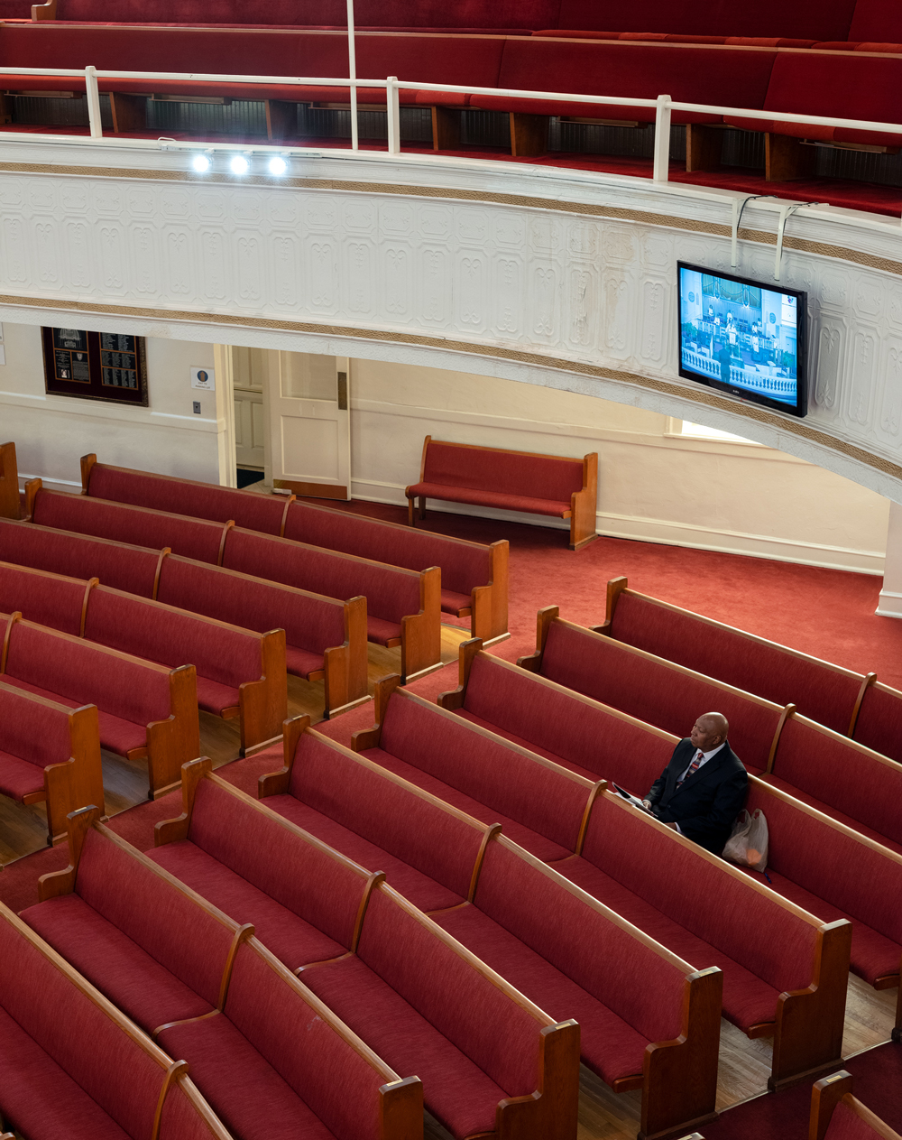 A man listens to Easter service at Big Bethel AME Church as it's being broadcast online.