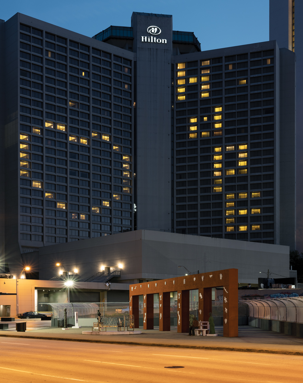 The Hilton Hotel with lights on in rooms used to spell HOPE with a heart