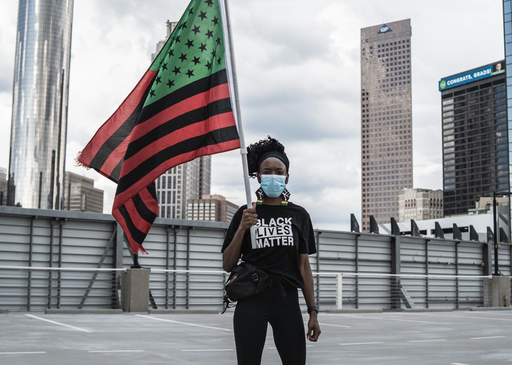 protestor holding flag