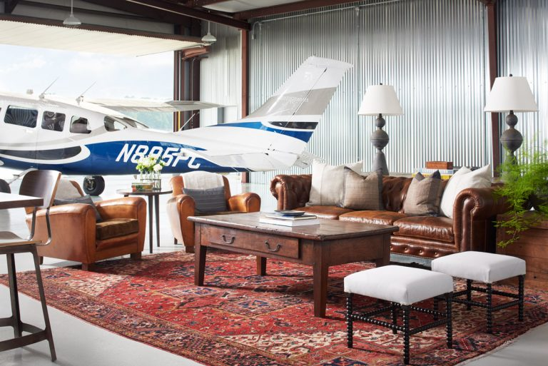 An office and retreat in an airplane hangar gives a nod to the golden age of aviation