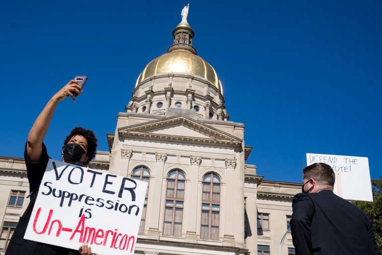 """Here's what's going on with voting legislation in Georgia and why opponents say it's clear """"voter suppression"""""""