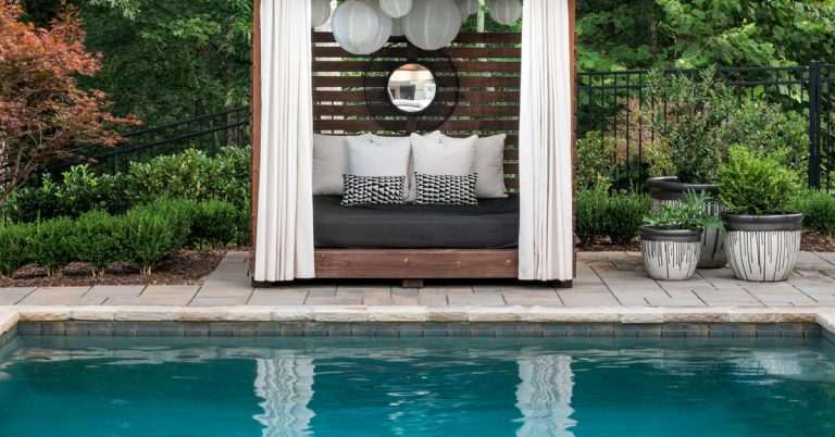 A custom shelter helped turn this Gainesville pool into an outdoor oasis