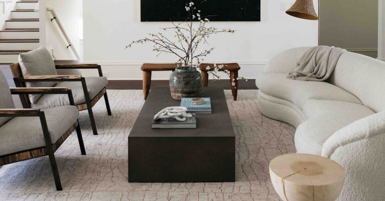 One-of-a-kind furniture and interesting textures spice up this neutral living room