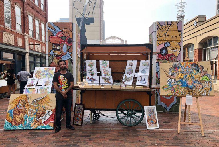 A pop-up event transforms Underground Atlanta's wooden cart kiosks into works of art